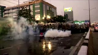 Police clash with anti-government protesters in Bangkok