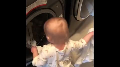 Watch this helpful baby assist mommy with the laundry!