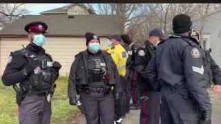 97 Toronto Police Stand to Prevent business from Opening