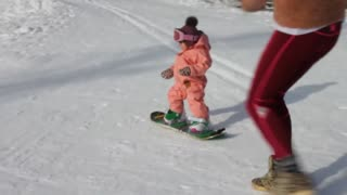 9-Month-Old Snowboarder Takes On The Slopes - Video