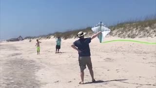 Guy releases kite into air, instantly flies back to hit him