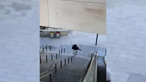 Guy Slides Down A Handrail On His Behind