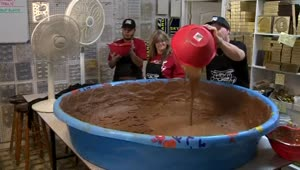 Candy shop attempts world record for largest peanut butter cup - Video