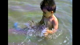 Toddler enjoys fun in the sea - Video