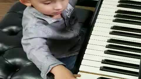 1 year old playing the piano for the first time