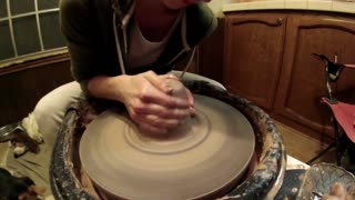 Emily throwing pottery