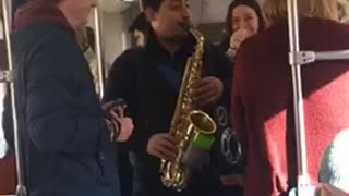 Guy playing saxophone on subway train - Video