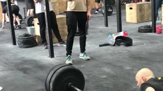 Two guys workout jumping over weight bar lift fail push up