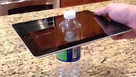 Drilling through an iPad with a water bottle