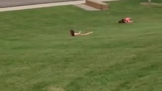 Rolling down a grass hill and can no longer walk  - Video