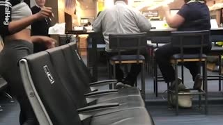 Woman At Airport Limbos Under Chair - Video