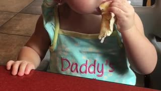 Baby loves burrito so much she starts dancing!  - Video