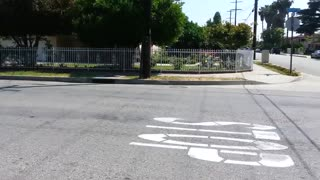 Two El Monte Police cars FLOORING IT and catch air on a code 3 call! - Video