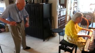 Elderly couple dance and play piano - Video
