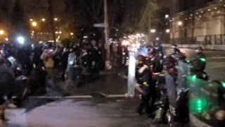 Happy New Year from antifa. Police line forced back in Portland.