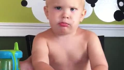 Baby shows off his mean face and totally kills it
