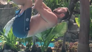 Guy slow motion rope swing fail into pool lands on back