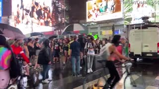 Car Drives Through Times Square Protesters