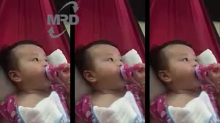 Baby drinking bottle milk - 3 months old