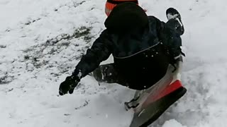 Collab copyright protection - kid orange hat faceplants in snow - Video