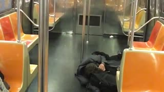 Man in all black passed out on floor