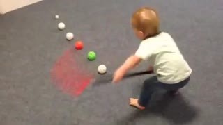 Baby shows off jaw-dropping slap shot skills - Video