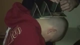 Stacking cards on passed out guys head
