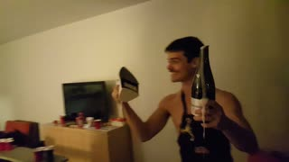 Mustache guy opens champagne bottle with iron - Video