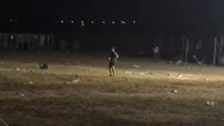 Guy alone in baseball field dancing  - Video