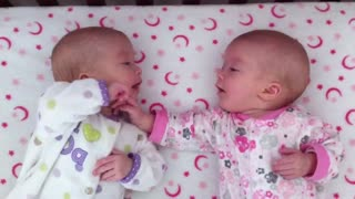 Identical twin babies interact for the very first time - Video