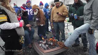 Bills Fan Runs Into MASSIVE FIRE PIT - Video