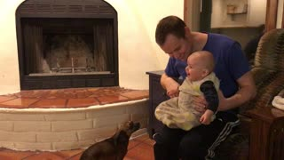 Cute baby can't stop laughing at jumping puppy - Video