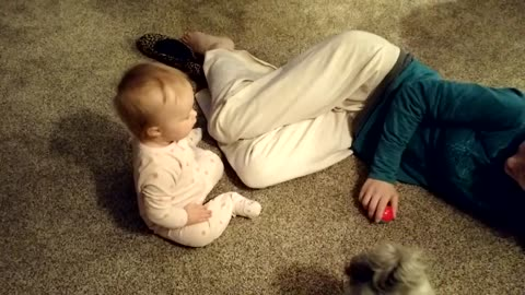 Baby adorably learns to share toys