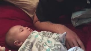 Adorable baby doesn't want to wake up