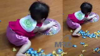 Baby playing with candy - Video