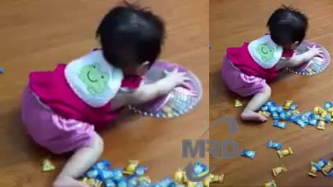 Baby playing with candy