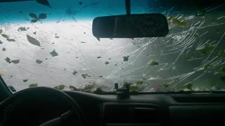 Freak hail storm destroys windshield - Video