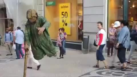 Street performer levitates for passing tourists
