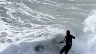 Surfers ride waves in epic slow motion