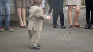 Little boy dances to traditional music
