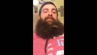 Snake slithers through man's beard - Video