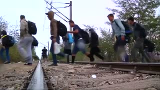 Amid refugee crisis, Merkel calls for quota system - Video