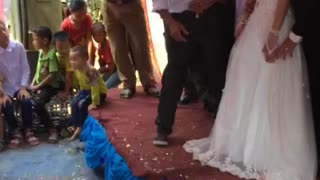 Stage Collapses Under Bride and Groom