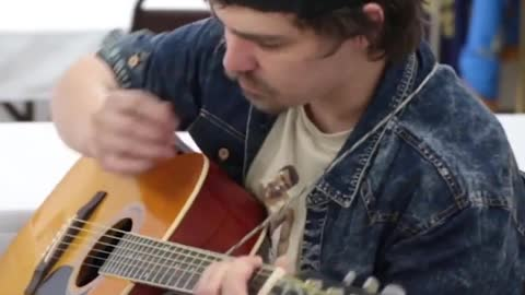 Guy makes guitar mastery seem completely effortless