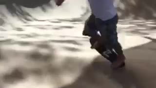 Barefoot guy with white shirt skateboards on ramp and falls off board  - Video