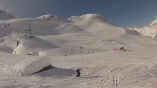 Guy skis off rock face plants into snow