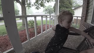 4 Year Old Plays Enjoys Rain Storm