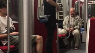 Guy playing accordion subway black clothes white shoes - Video