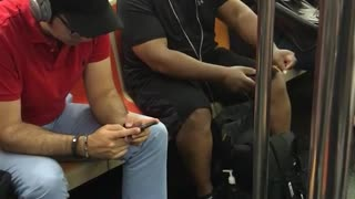 Guy white headphones dancing on subway seat black clothes - Video