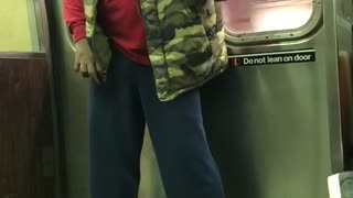 Camo vest red shirt headphones singing jackson 5 song subway - Video